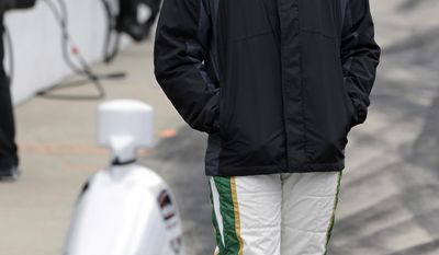 Driver Ed Carpenter waits in the pit area during a rain delay for the start of practice for Indianapolis 500 IndyCar auto race at the Indianapolis Motor Speedway in Indianapolis, Friday, May 16, 2014. (AP Photo/Darron Cummings)