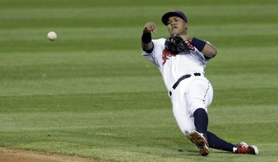 Cleveland Indians' Jose Ramirez throws out Oakland Athletics' Eric Sogard at first base in the fifth inning of a baseball game, Friday, May 16, 2014, in Cleveland. (AP Photo/Tony Dejak)