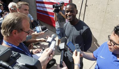 United States' Maurice Edu fields questions from the media during a training session in preparation for the World Cup soccer tournament on Friday, May 16, 2014, in Stanford, Calif. (AP Photo/Marcio Jose Sanchez)