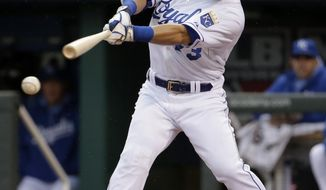 Kansas City Royals' Norichika Aoki hits a double during the first inning of a baseball game against the Baltimore Orioles on Friday, May 16, 2014, in Kansas City, Mo. (AP Photo/Charlie Riedel)
