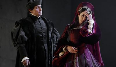 """In this Thursday, May 15, 2014 photo, a scene from 'Bring up the Bodies' with Ben Miles as Thomas Cromwell, left, and Lydia Leonard as Anne Boleyn, right, during a media opportunity at the Aldwych Theatre in London. Hilary Mantel's Booker Prize-winning best-seller about deadly intrigue at the court of King Henry VIII will soon be a BBC series with Tony Award-winner Mark Rylance and """"Homeland"""" star Damian Lewis. """"Wolf Hall"""" and sequel """"Bring Up the Bodies"""" have already been adapted into plays that plunge audiences into a world of murky Tudor machinations. As the plays move to London's West End after a rave-gathering run at the Royal Shakespeare Company in Stratford-upon-Avon, Mantel said the characters' complex motives and shades of gray were key to the stories' adaptability. (AP Photo/Kirsty Wigglesworth)"""