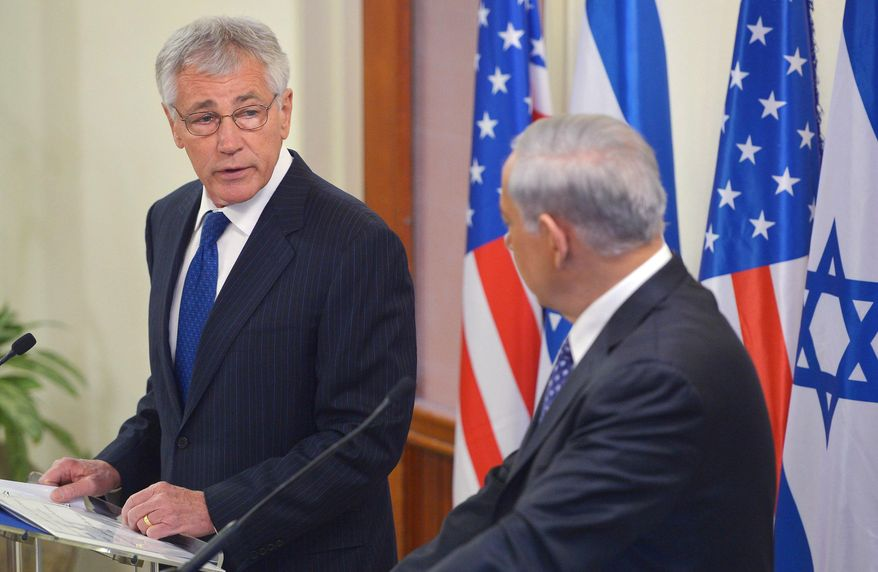 U.S. Defense Secretary Chuck Hagel, left, speaks during a joint press conference with Israeli Prime Minister Benjamin Netanyahu at the prime minister's office Friday, May 16, 2014 in Jerusalem. (AP Photo/Mandel Ngan, Pool)