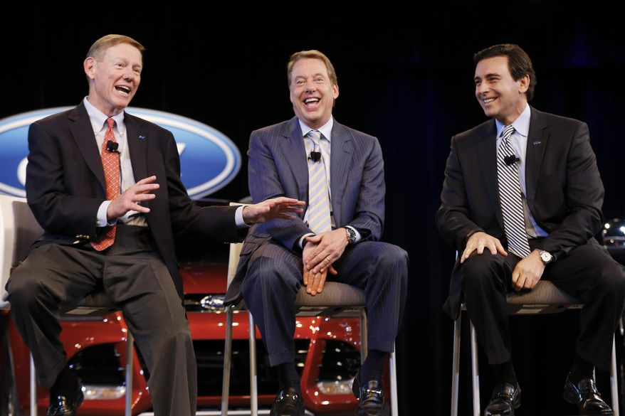 FILE -  In this May 1, 2014 file photo, Ford Motor Company President and CEO Alan Mulally, left, Executive Chairman Bill Ford Jr., center, and Chief Operating Officer Mark Fields speak during a news conference in Dearborn, Mich.  Taking over for Mulally when he retires July 1, Fields, who was instrumental Ford's turnaround, will inherit a healthy company. But he will have to push the company for bigger growth. (AP Photo/Paul Sancya, File)