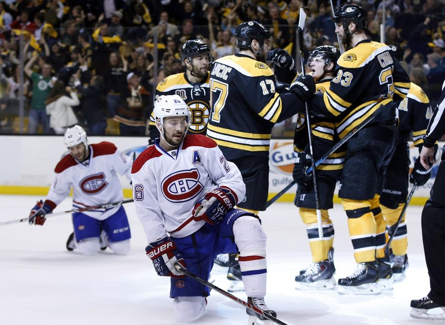 Montreal Canadiens defensemen Josh Gorges (26) and Mike Weaver, left, react as Boston Bruins defenseman Zdeno Chara (33), defenseman Torey Krug (47) and left wing Milan Lucic (17) celebrate a goal by right wing Jarome Iginla, left, during the second period in Game 7 of an NHL hockey second-round playoff series in Boston, Wednesday, May 14, 2014. (AP Photo/Elise Amendola)
