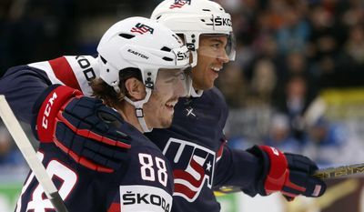 USA defender Seth Jones, right, and forward Peter Mueller celebrate a goal during the Group B preliminary round match between USA and Kazakhstan at the Ice Hockey World Championship in Minsk, Belarus, Friday, May 16, 2014. (AP Photo/Darko Bandic)