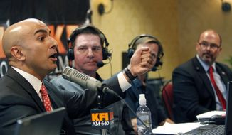 California Republican gubernatorial candidates Neel Kashkari, left, talks in a radio debate with State Assemblyman Tim Donnelly, far right, on Thursday, May 15, 2014, in Anaheim, Calif. (AP Photo/Alex Gallardo)