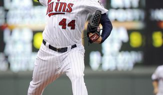 Minnesota Twins starting pitcher Kyle Gibson (44) throws against the Seattle Mariners during the first inning of a baseball game in Minneapolis, Friday, May, 16, 2014. (AP Photo/Craig Lassig)