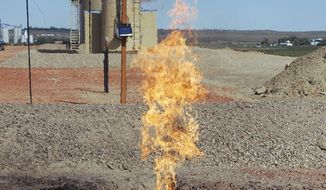 """FILE - In this Sept. 23, 2008 file photo, natural gas is flared from an oil well near Parshall, N.D. A federal judge has dismissed lawsuits from several North Dakotans who claimed they are owed millions of dollars from oil drilling companies that are burning and wasting natural gas instead of capturing it. U.S. District Judge Daniel Hovland's ruling, filed Wednesday, May 14, 2014, said the federal government lacks jurisdiction in the cases because the mineral owners did not """"exhaust administrative remedies"""" with state regulators. (AP Photo/James MacPherson, File)"""