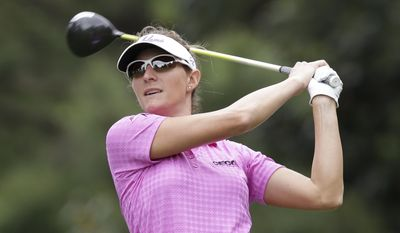 Brittany Lang watches her tee shot on the ninth hole during the second round of the LPGA Kingsmill Championship golf tournament at the Kingsmill resort in Williamsburg, Va., Friday, May 16, 2014. (AP Photo/Steve Helber)