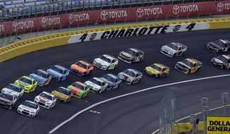 Drivers navigate Turn 4 as they approach the start of the NASCAR Sprint Showdown auto race at the Charlotte Motor Speedway in Concord, N.C., Friday, May 16, 2014. (AP Photo/Gerry Broome)