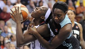 Connecticut Sun's Chiney Ogwumike, left, is fouled by New York Liberty's Tina Charles during the first half of their WNBA basketball game in Uncasville, Conn., Friday, May 16, 2014. (AP Photo/Fred Beckham)
