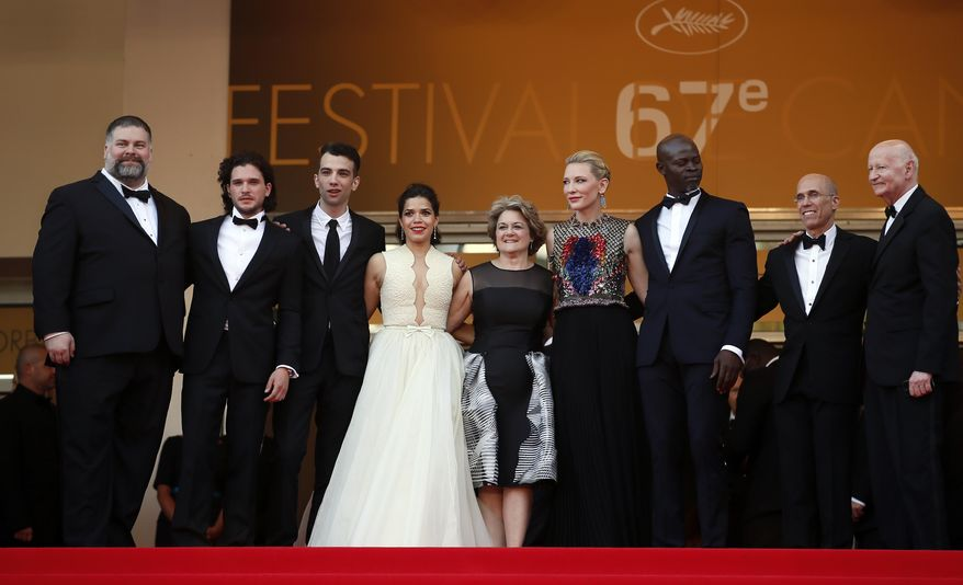 From left, director Dean Deblois, actor Kit Harington, actor Jay Baruchel, actress America Ferrera, producer Bonnie Arnold, actress Cate Blanchett, actor Dijmon Hounsou and head of Dreamworks Jeffrey Katzenberg pose at the top of the red carpet for the screening of How to Train Your Dragon 2 at the 67th international film festival, Cannes, southern France, Friday, May 16, 2014. (AP Photo/Alastair Grant)
