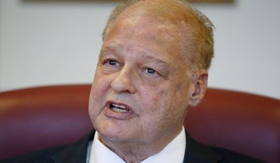 Arizona Attorney General Tom Horne speaks during an interview saying prosecutor Yavapai County Attorney Sheila Polk's decision to overrule an administrative law judge's decision shows she just couldn't take losing the case and who reinstated a campaign finance case against him is a sore loser, on Thursday, May 15, 2014, in Phoenix. (AP Photo/Ross D. Franklin)