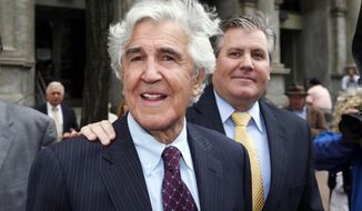 Former state Senator Joseph Bruno, left, and his son Ken Bruno walk away from the federal courthouse after a jury found him not guilty of federal fraud charges on Friday, May 16, 2014, in Albany, N.Y.  Bruno was accused of accepting $360,000 in consulting fees in monthly installments in 2004-2005, plus $80,000 for his share in a worthless racehorse, from Abbruzzese in return for helping his businesses with state grants and advancing his interest in New York's thoroughbred racing. (AP Photo/Mike Groll)