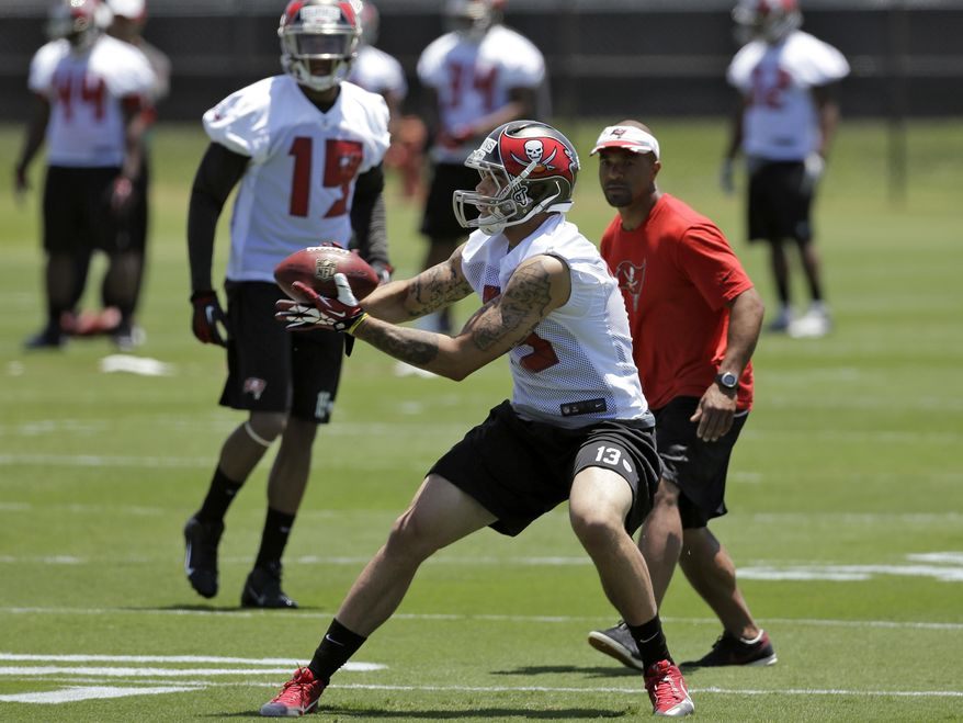 Tampa Bay Buccaneers first-round draft pick Mike Evans (13) catches a pass during NFL football rookie camp Friday, May 16, 2014, in Tampa, Fla. Evans, the seventh pick overall, played at Texas A&M. (AP Photo/Chris O'Meara)