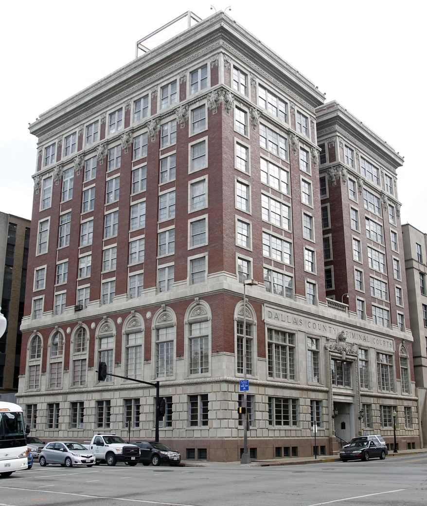 This March 28, 2014 photo shows the old Dallas County Criminal Courts Building in downtown Dallas.  The ornate brick building, at the northeast corner of Main and Houston streets, was completed in 1915.  The rot of time is taking a toll.   Two young preservationists, Inga Bursing, a 34-year-old lawyer, and Charles Stokes, a 22-year-old college student,  are stepping forward to grapple with the building's complex history as they push for its restoration. (AP Photo/The Dallas Morning News, Michael Ainsworth)  MANDATORY CREDIT; MAGS OUT; TV OUT; INTERNET USE BY AP MEMBERS ONLY; NO SALES