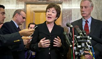 FILE - Following a meeting with Sen.-elect Angus King of Maine, right, Sen. Susan Collins, R-Maine, tells reporters that she wants answers from disgraced CIA Director David Petraeus, in this Tuesday, Nov. 13, 2012 file photo. Independent U.S. Sen. Angus King may caucus with Democrats but he's endorsing Republican colleague Susan Collins in her bid for a fourth term in the Senate. The two are to appear together Friday May 16, 2014 at the Margaret Chase Smith Library in Skowhegan.  (AP Photo/J. Scott Applewhite, File)