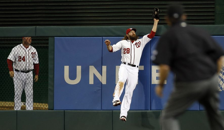 Washington Nationals right fielder Jayson Werth jumps to make a catch on a fly ball hit by New York Mets' Daniel Murphy, for the final out of the ninth inning of a baseball game at Nationals Park Friday, May 16, 2014, in Washington. The Nationals won 5-2. (AP Photo/Alex Brandon)