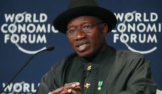 ** FILE ** In this Thursday, May 8, 2014, file photo, Nigeria President Goodluck Jonathan speaks during the World Economic Forum on Africa in Abuja, Nigeria. (AP Photo/Sunday Alamba, File)