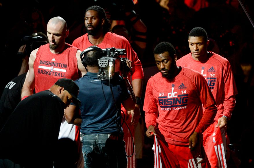 Left to right: Washington Wizards center Marcin Gortat (4), Washington Wizards forward Nene Hilario (42), Washington Wizards guard John Wall (2), and Washington Wizards guard Bradley Beal (3), are introduced before the Washington Wizards play the Indiana Pacers during game 6 of the 2nd round of the NBA Playoffs at the Verizon Center, Washington, D.C., Thursday, May 15, 2014. (Andrew Harnik/The Washington Times)