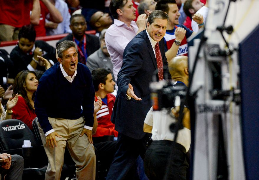 Washington Wizards head coach Randy Wittman, right, and Washington Wizards owner Ted Leonsis, left, as the Washington Wizards lose to the Indiana Pacers, 93-80, during game 6 of the 2nd round of the NBA Playoffs at the Verizon Center, Washington, D.C., Thursday, May 15, 2014. (Andrew Harnik/The Washington Times)