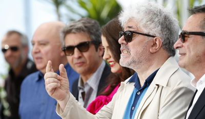producer Pedro Almodovar, second right, poses with, from left, producer Augustin Almodovar, actor Ricardo Darin, actress Erica Rivas and actor Oscar Martinez during a photo call for Wild Tales (Relatos Salvajes) at the 67th international film festival, Cannes, southern France, Saturday, May 17, 2014. (AP Photo/Alastair Grant)