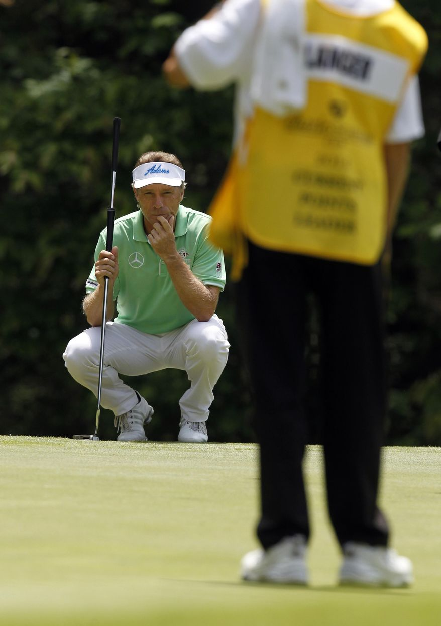Bernhard Langer lines up his put during the third round at the Region's Tradition of the Champions Tour on Saturday, May 17, 2014, in Birmingham, Ala. (AP Photo/Butch Dill)