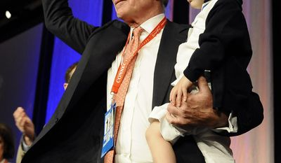 Republican candidate for governor Tom Foley waves as he holds his son Reed while accepting the nomination for governor at the Connecticut Republican Convention, Saturday, May 17, 2014, in Uncasville, Conn. (AP Photo/Jessica Hill)