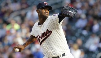 Minnesota Twins starting pitcher Samuel Deduno delivers to the Seattle Mariners during the first inning of a baseball game in Minneapolis, Saturday, May 17, 2014. (AP Photo/Ann Heisenfelt)