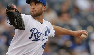 Kansas City Royals pitcher Danny Duffy delivers to a Baltimore Orioles batter during the first inning of a baseball game at Kauffman Stadium in Kansas City, Mo., Saturday, May 17, 2014. (AP Photo/Orlin Wagner)