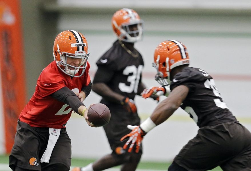 Cleveland Browns quarterback Johnny ManzielMatthew Willis during rookie minicamp practice at the NFL football team's facility in Berea, Ohio Saturday, May 17, 2014. (AP Photo/Mark Duncan)