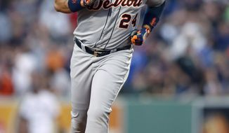 Detroit Tigers' Miguel Cabrera (24) rounds second base on a solo home run in the third inning of a baseball game against the Boston Red Sox in Boston, Saturday, May 17, 2014. (AP Photo/Michael Dwyer)