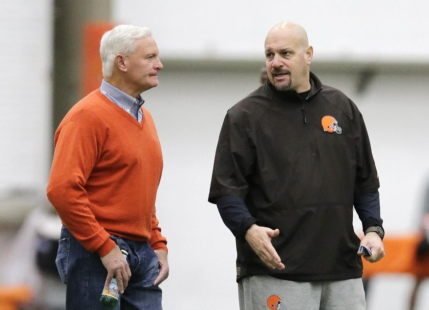 Cleveland Browns head coach Mike Pettine, right, talks with owner Jimmy Haslam during rookie minicamp practice at the NFL football team's facility in Berea, Ohio Saturday, May 17, 2014. (AP Photo/Mark Duncan)