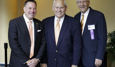 Tennessee football coach Butch Jones, left, poses with former Tennessee coaches Phil Fulmer, center, and Doug Dickey before the inductions to the Tennessee Sports Hall of Fame on  Saturday, May 17, 2014, in Nashville, Tenn. (AP Photo/Mark Humphrey)