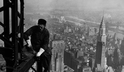 "This photo circa 1930-1931 released by the National Archives, Records of the Works Progress Administration shows a workman on the framework of the Empire State Building in New York. The photo is part of ""The Way We Worked"" , part of the Smithsonian's Museum on Main Street program ? and opens Saturday, May 17, 2014 in Angola,  Louisiana, and 270 miles away in Tunica, Mississippi. Identical exhibits also are being shown in Rhode Island, Michigan and California. (AP Photo/National Archives, Records of the Works Progress Administration)"