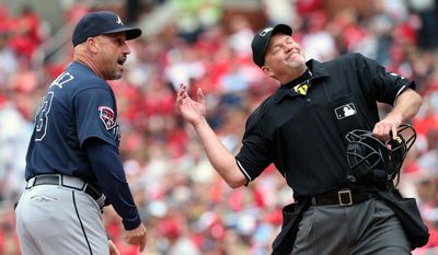 Atlanta Braves manager Fredi Gonzalez, left, is ejected from the game while arguing with home plate umpire Ron Kulpa, right, during the fifth inning of a baseball game against the St. Louis Cardinals on Saturday, May 17, 2014, in St. Louis. (AP Photo/St. Louis Post-Dispatch, Chris Lee)  EDWARDSVILLE INTELLIGENCER OUT; THE ALTON TELEGRAPH OUT