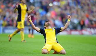 Atletico's David Villa celebrates after a Spanish La Liga soccer match between FC Barcelona and Atletico Madrid at the Camp Nou stadium in Barcelona, Spain, Saturday, May 17, 2014. Atletico clinched its first league title in 18 years after a 1-1 draw. (AP Photo/Manu Fernandez)