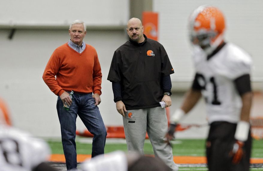 Cleveland Browns owner Jimmy Haslam, left, and head coach Mike Pettine watch rookie minicamp practice at the NFL football team's facility in Berea, Ohio Saturday, May 17, 2014. (AP Photo/Mark Duncan)