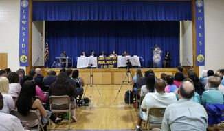 In a Tuesday, May 13, 2014 photo, five of the seven candidates for Congress in the 1st District participate in a debate in Lawnside, N.J. From the left; Sen. Donald Norcross, Frank Broomell Jr., Mayor Frank Minor, Clair Gufstafson and Gerard McManus. Former NFL linebacker Garry Cobb and commercial food equipment repairman Lee Lucas did not attend the NAACP sponsored debate. (AP Photo/Mel Evans)
