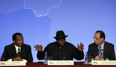 """Nigeria President Goodluck Jonathan, center, answers reporter's questions as Cameroon President Paul Biya, left, and French President Francois Hollande look on during the press conference ending the """"Paris Summit for Security in Nigeria"""", at the Elysee Palace, in Paris, Saturday, May 17, 2014. Leaders from Africa as well as officials from the United States, Britain and France met to coordinate a response to Boko Haram, the fundamentalist group that abducted more than 300 girls and is accused of hundreds of deaths in the past year alone.(AP Photo/Francois Mori)"""