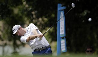 Brendon Todd hits off the first tee during the third round of the Byron Nelson Championship golf tournament, Saturday, May 17, 2014, in Irving, Texas. (AP Photo/Tony Gutierrez)