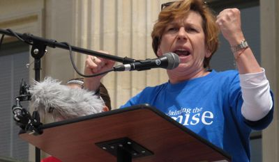Randi Weingarten, president of the American Federation of Teachers, speaks at a rally for Kansas public schools, Saturday, May 17, 2014, at the Statehouse in Topeka, Kan. She and other educators are criticizing Republican Gov. Sam Brownback over his education policies. (AP Photo/John Hanna)