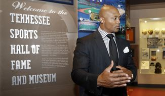 Former Tennessee Titans running back Eddie George talks with guests before the induction ceremony for the Tennessee Sports Hall of Fame on Saturday, May 17, 2014, in Nashville, Tenn. George is one of the 2014 inductees. (AP Photo/Mark Humphrey)