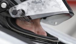 FILE - In this May 15, 2014, file photo, driver Kurt Busch sits in his car during practice for Indianapolis 500 IndyCar auto race at the Indianapolis Motor Speedway in Indianapolis. On Memorial Day weekend, NASCAR's bad boy is trying to own the title of baddest man on the track by pulling off racing's version of an IronMan triathlon. In a single day, he'll try and race in the Indianapolis 500 and the Coca-Cola 600, with a race or two against the clock thrown in. (AP Photo/Darron Cummings, File)