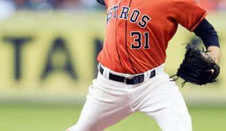 Houston Astros starting pitcher Collin McHugh  throws in the first inning against the Chicago White Sox during a baseball game on Friday, May 16, 2014, in Houston. (AP Photo/Bob Levey)