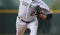 Colorado Rockies starting pitcher Jordan Lyles works against the San Diego Padres in the first inning of a baseball game in Denver on Saturday, May 17, 2014. (AP Photo/David Zalubowski)