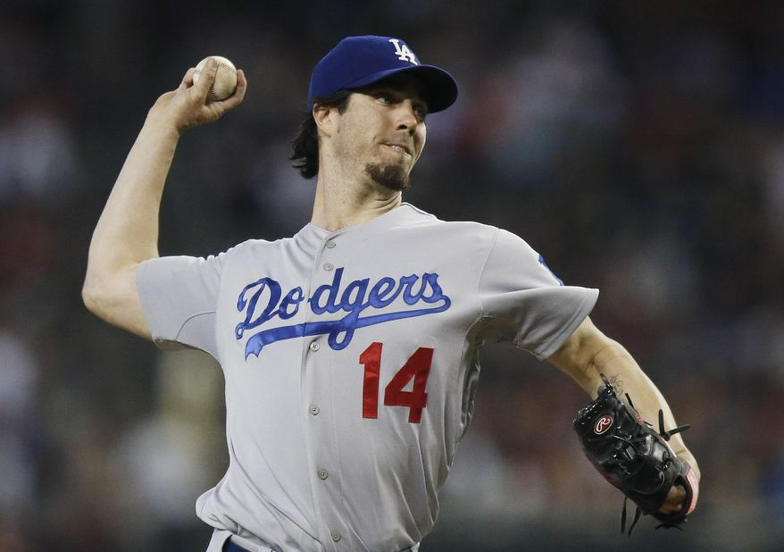 Los Angeles Dodgers' Dan Haren throws a pitch against the Arizona Diamondbacks during the first inning of a baseball game on Sunday, May 18, 2014, in Phoenix. (AP Photo/Ross D. Franklin)