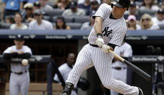 New York Yankees' Mark Teixeira hits a two-run single during the first inning of the first baseball game of a double-header against the Pittsburgh Pirates at Yankee Stadium, Sunday, May 18, 2014 in New York. (AP Photo/Seth Wenig)
