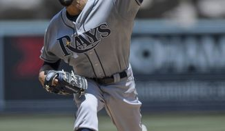 Tampa Bay Rays starting pitcher David Price pitches during the first inning of a baseball game against the Los Angeles Angels in Anaheim, Calif., Sunday, May 18, 2014. (AP Photo/Kelvin Kuo)