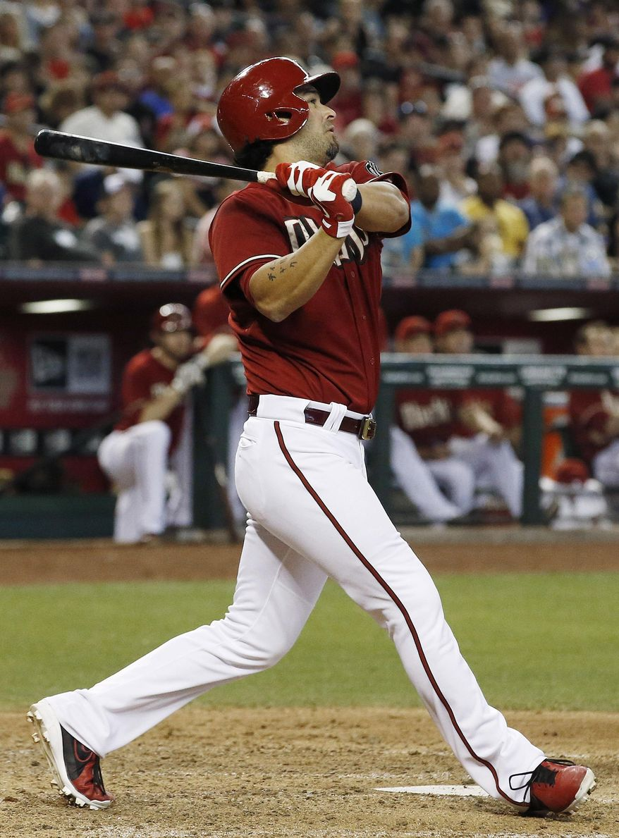 Arizona Diamondbacks' Eric Chavez connects on a 2-run home run against the Los Angeles Dodgers during the fifth inning of a baseball game on Sunday, May 18, 2014, in Phoenix. (AP Photo/Ross D. Franklin)